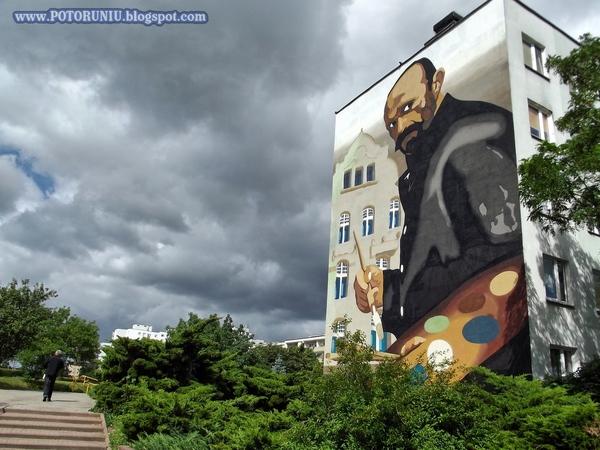http://s24.flog.pl/media/foto_middle/12194389_julian-falat-na-muralu.jpg